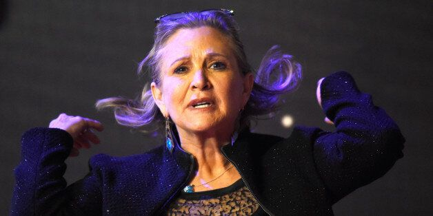 Carrie Fisher poses for cameras as she arrives at the European Premiere of Star Wars, The Force Awakens...