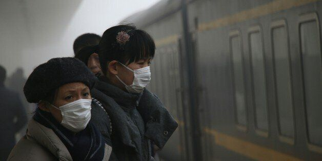 JINAN, CHINA - JANUARY 05: Passengers wait at the railway station as smog has grounded flights and closed...