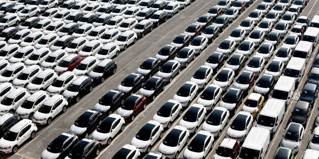 New imported automobiles, including some manufactured by Nissan Motor Co., sit with other marques at...