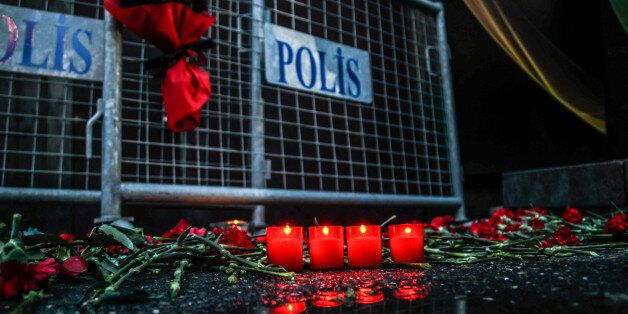 ISTANBUL, TURKEY - JANUARY 1: Flowers and candles are placed out side the Reina nightclub by the Bosphorus,...