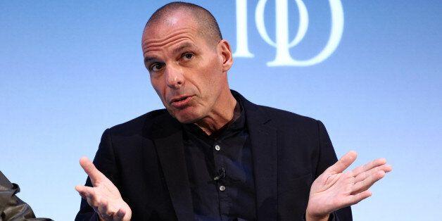 Yanis Varoufakis, former Greek finance minister, gestures whilst speaking during the Institute of Directors...