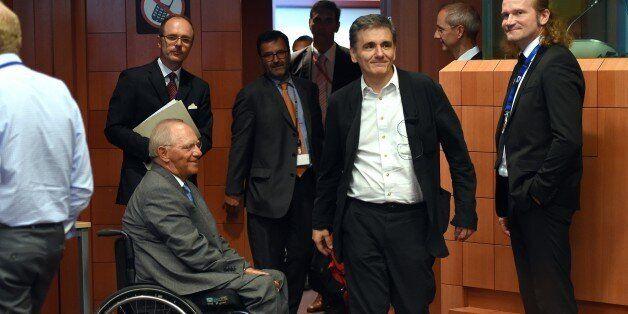 German Finance Minister Wolfgang Schauble (CL) and Greece's Finance Minister Euclid Tsakalotos (CR) attend...