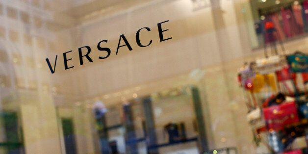 A sign is seen for high-end retail store Versace along 5th Avenue in New York May 19, 2013. Luxury spending...