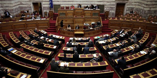 Greek lawmakers attend a parliamentary session before a vote on a one-off benefit approved to pensioners...