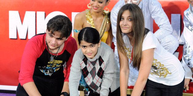 Singer Michael Jackson is immortalized in a ceremony where his children (L-R) Prince, Blanket and Paris use Jackson's shoes and gloves and their own hands to make imprints in cement in the courtyard of Hollywood's Grauman's Chinese Theatre in Los Angeles on January 26, 2012. REUTERS/Phil McCarten (UNITED STATES - Tags: ENTERTAINMENT)