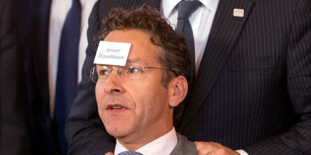 Netherlands State Secretary of Finance Jeroen Rene Dijsselbloem has his name stuck to his head as they...