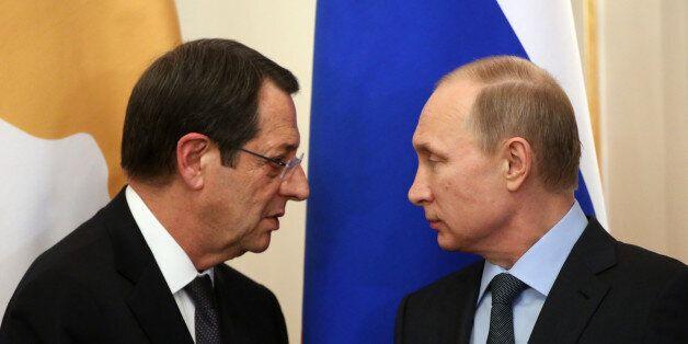 MOSCOW, RUSSIA - FEBRUARY 25: Russian President Vladimir Putin (R) and Cyprus President Nicos Anastasiades...