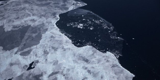ANTARCTICA - OCTOBER 28: Sea ice floats near the coast of West Antarctica from a window of a NASA Operation...