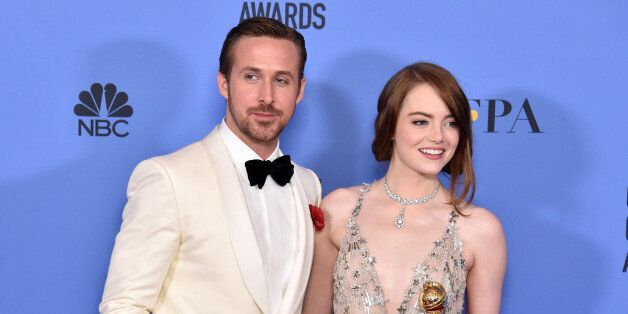 BEVERLY HILLS, CA - JANUARY 08: Actor Ryan Gosling (L) and actress Emma Stone pose in the press room...