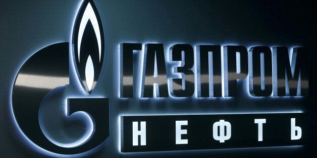 A sign displaying the logo of Russia's Gazprom Neft oil company is seen at the company's office in the...