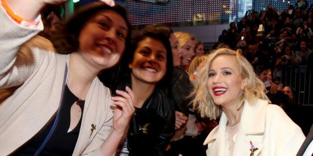 LOS ANGELES, CA - NOVEMBER 16:  Fans take a Selfie with actress Jennifer Lawrence (R) at the premiere of The Hunger Games: Mockingjay – Part 2 on November 16, 2015 in Los Angeles, California  (Photo by Jonathan Leibson/Getty Images for Samsung)