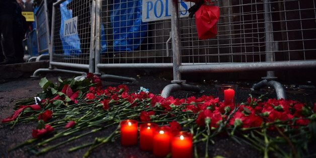 Flowers have been laid in front of the Reina night on January 1, 2017 in Istanbul, after a gunman killed...