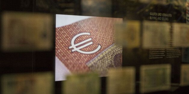 An illuminated signs shows the euro currency symbol on display inside the Deutsche Bundesbank's money...
