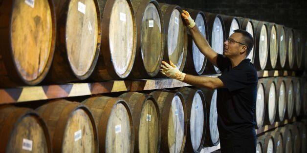 Danny Borzacciello stores a barrel at the Auchentoshan Distillery, a Single Malt whisky distillery, on...