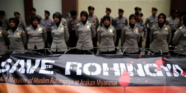A banner is tied to barbed-wire outside the Myanmar embassy during a protest against what organisers...