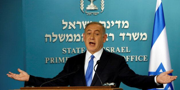 Israeli Prime Minister Benjamin Netanyahu delivers a speech in his office in his Jerusalem office December...