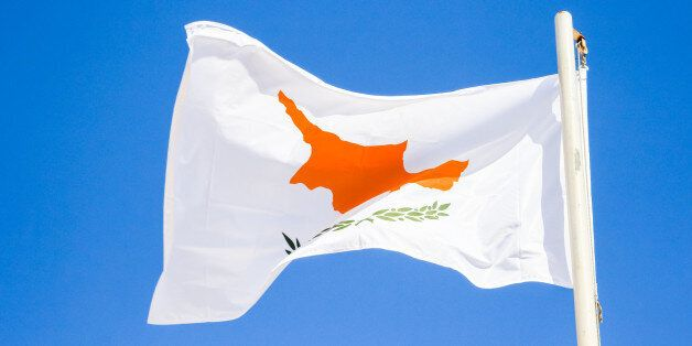 Waving flag of Cyprus on the blue sky background, Agia