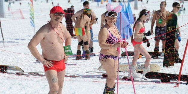 KEMEROVO REGION, RUSSIA. APRIL 16, 2016. Skiers and snowboarders in bathing suits take part in a mass...