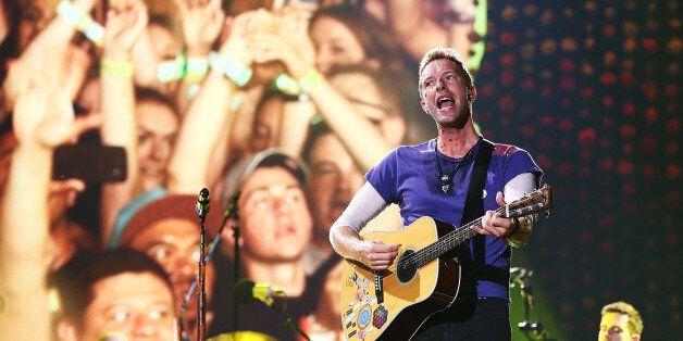 SYDNEY, AUSTRALIA - DECEMBER 13: Chris Martin of Coldplay performs at Allianz Stadium on December 13,...