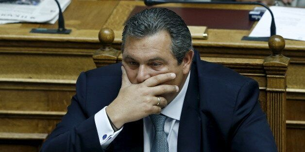 Greek Defense Minister and leader of minor coalition party Independent Greeks Panos Kammenos gestures...