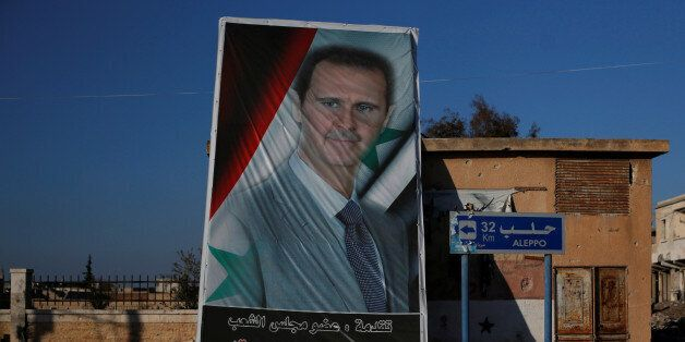 A picture of Syria's President Bashar al-Assad is seen in Ramouseh, a government controlled area of Aleppo,...