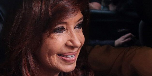 Former Argentine President Cristina Fernandez de Kirchner leaves her home to go to court in Buenos Aires,...