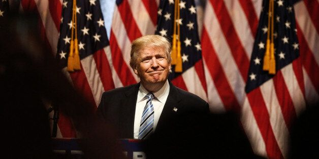 Donald Trump, presumptive 2016 Republican presidential nominee, smiles during a campaign event in New...