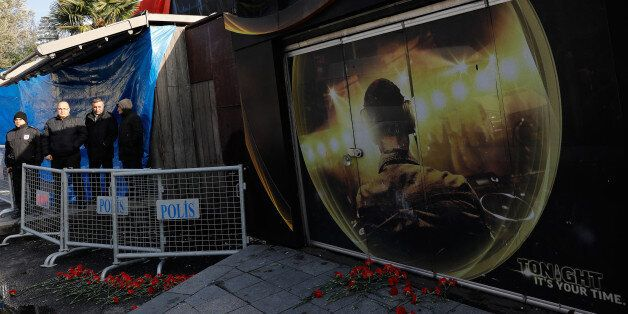 A group of people stands outisde the Reina nightclub by the Bosphorus, which was attacked by a gunman,...