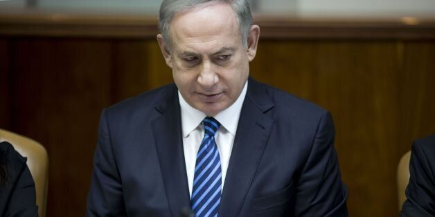 Israeli Prime Minister Benjamin Netanyahu chairs the weekly cabinet meeting at his office in Jerusalem...