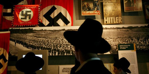 Ultra-Orthodox Jewish men visit the Yad Vashem Holocaust Museum in Jerusalem April 24, 2006. Israel marks...