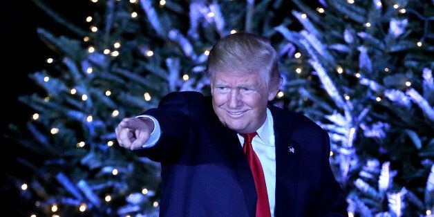President-elect Donald Trump responds to cheering supporters in front of a Christmas-themed backdrop...