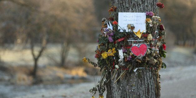 FREIBURG IM BREISGAU, GERMANY - DECEMBER 08: Flowers and messages left by mourners adorn a tree near...