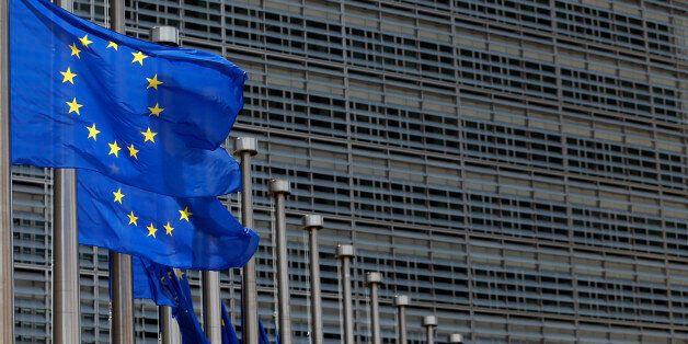 European Union flags set of half staff outside the European Commission headquarters in Brussels, Belgium,...