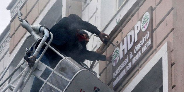 TURKEY OUTThis picture obtained from Dogan News Agency shows protesters breaking and removing the logo...