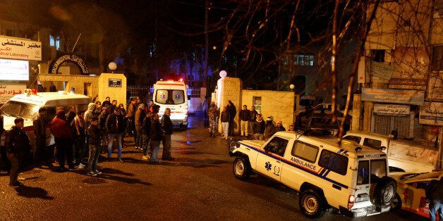 Ambulances are seen in front of the Italian hospital where some of the injured were evacuated to after...