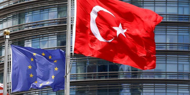 A European Union (L) and Turkish flag fly outside a hotel in Istanbul, Turkey, May 4, 2016. REUTERS/Murad...