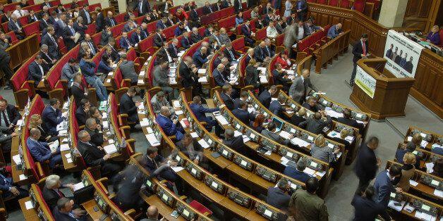 Ukrainian lawmakers declared dozens of millions of dollars in cash, fleets of luxury cars, expensive...