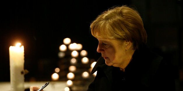 German Chancellor Angela Merkel signs the book of condolences on December 20, 2016 inside the Kaiser-Wilhelm-Gedaechtniskirche...