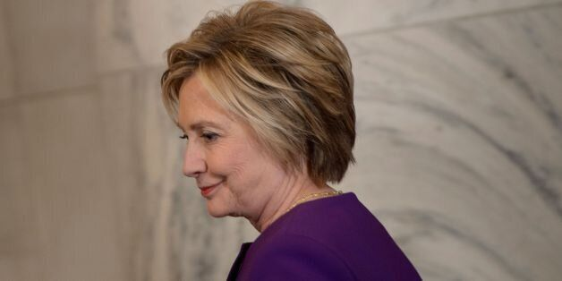 Former Democratic presidential candidate Hillary Clinton arrives for a portrait unveiling for outgoing...