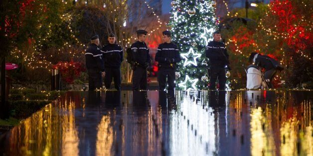 TOPSHOT - French Gendarmes patrol at the Christmas market in Tours, central France, on December 23, 2016....