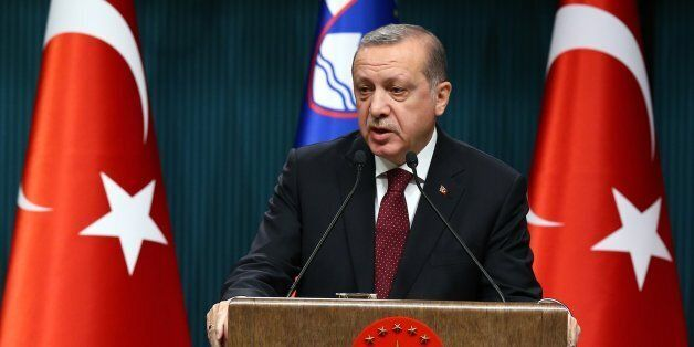 ANKARA, TURKEY - DECEMBER 15: Turkish President Recep Tayyip Erdogan (R) delivers a speech during a joint...