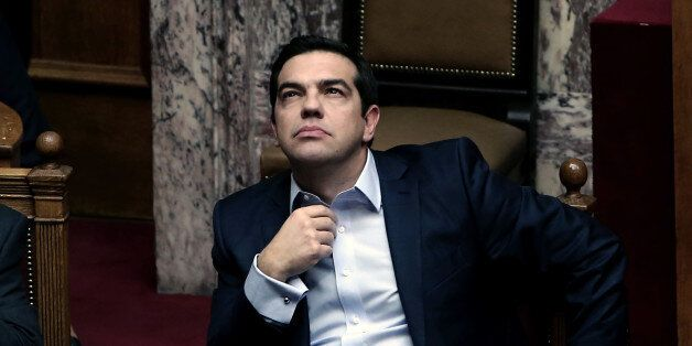 Greek Prime Minister Alexis Tsipras is seen during a parliamentary session in Athens on December 10,...