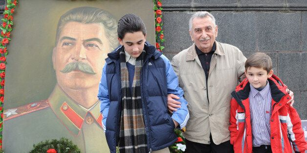 The grandson of Joseph Stalin (Dzhugashvili), Yevgeny Dzhugashvili (C) poses with his grandsons Josef...