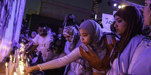 CAIRO, EGYPT - MAY 26: EgyptAir employees and relatives of the victims light candles during the commemoration...
