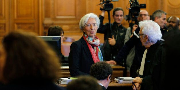 Managing Director of the International Monetary Fund (IMF) Christine Lagarde (R) talks with her lawyer...