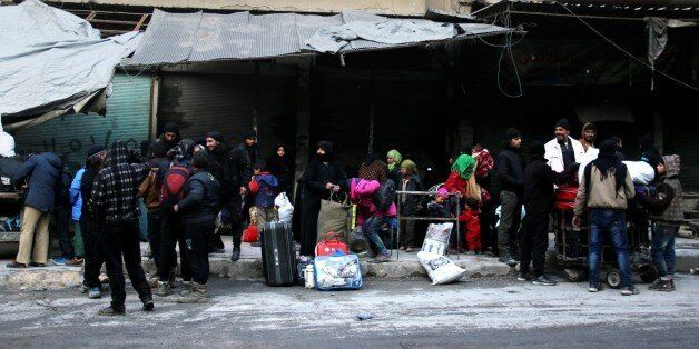 ALEPPO, SYRIA - DECEMBER 15: Civilians from the besieged area wait to be evacuated from eastern Aleppo...