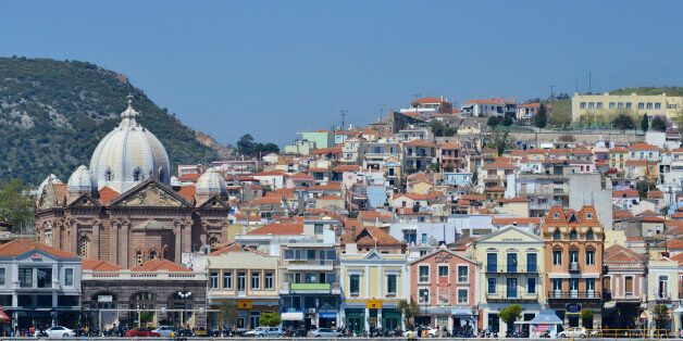 Waterfront at Mytilene town harbour. Agios Therapon church and many Neo-classical buildings. Mytilene...