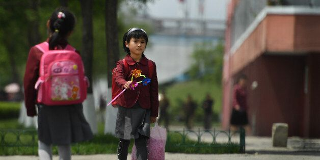 PYONGYANG, NORTH KOREA - MAY 9: Young girls walk by themselves without adults in Pyongyang, North Korea...