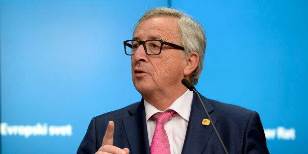 European Union Commission President Jean-Claude Juncker talks to the media at the end of a European Union...