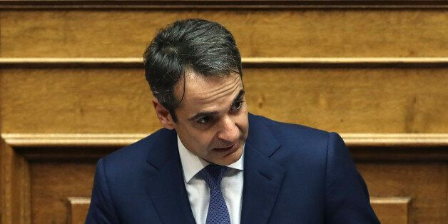 Kyriakos Mitsotakis, leader of conservative main opposition New Democracy party, addresses lawmakers...